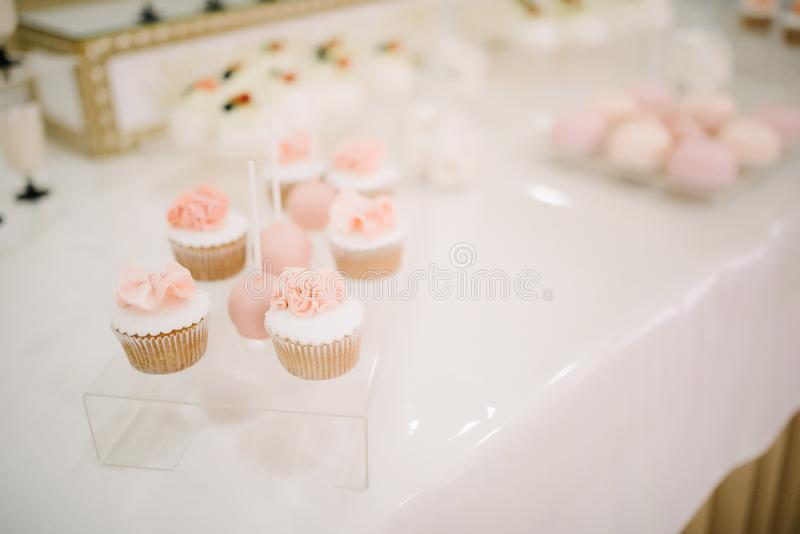 Sweet dessert table at a wedding.Cakestand at a wedding. Day nobody celebration candy food cupcake decorations buffet cream design chocolate stylish birthday royalty free stock image
