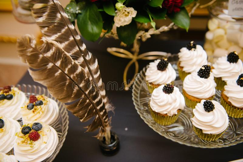 Sweet dessert table at a wedding.Cakestand at a wedding. Day nobody celebration candy food cupcake decorations buffet cream design chocolate stylish birthday royalty free stock photos