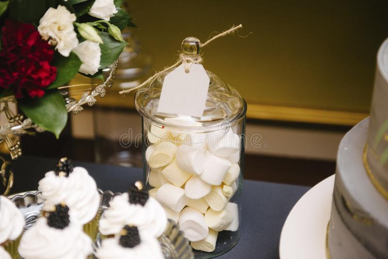 Sweet dessert table at a wedding.Cakestand at a wedding. Day nobody celebration candy food cupcake decorations buffet cream design chocolate stylish birthday royalty free stock photo