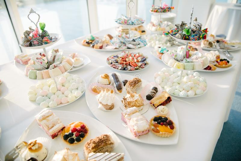Sweet dessert table at a wedding.Cakestand at a wedding. Day, nobody, celebration, candy, food, cupcake, decorations, buffet, cream, design, chocolate, stylish stock photos