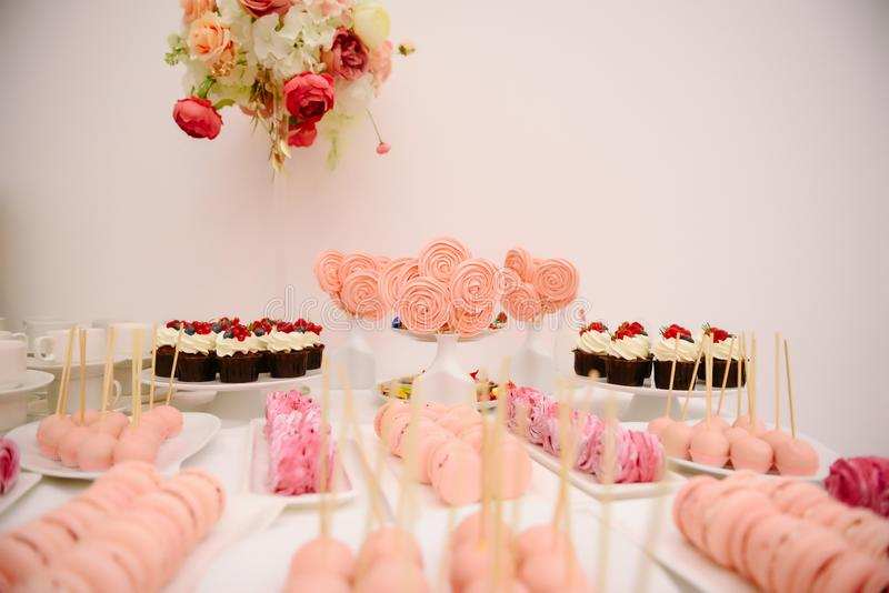 Sweet dessert table at a wedding.Cakestand at a wedding. Day, nobody, celebration, candy, food, cupcake, decorations, buffet, cream, design, chocolate, stylish royalty free stock photography