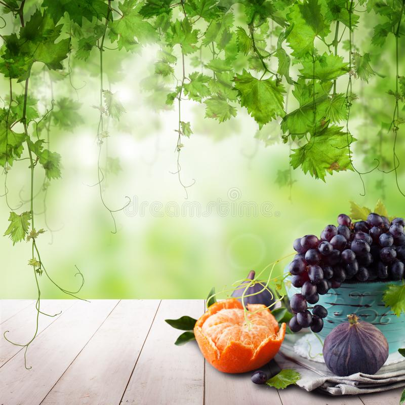 Sweet dessert on wooden table with green grapes leaves. Ecological fruit stock photos