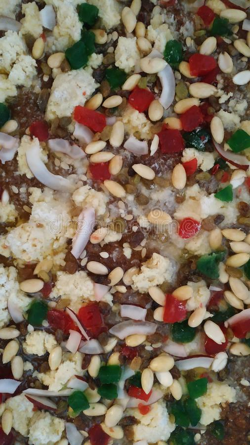 Sweet dish with layer of almonds, coconut, condensed milk stock images