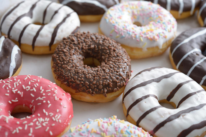 Sweet donuts. Assorted sweet donuts in a paper box stock image