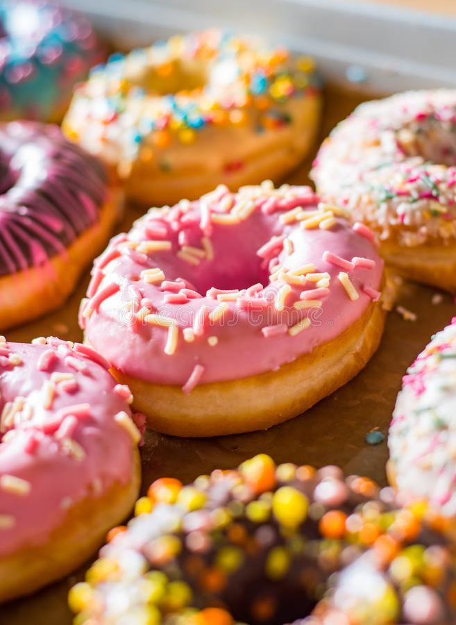 Sweet donuts in a paper box. Assorted sweet donuts in a paper box royalty free stock image