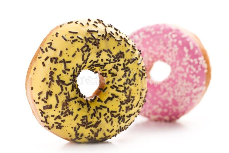 Sweet doughnut on white stock images