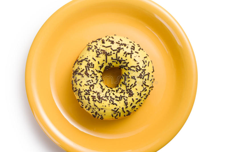 Sweet doughnut on yellow plate royalty free stock images