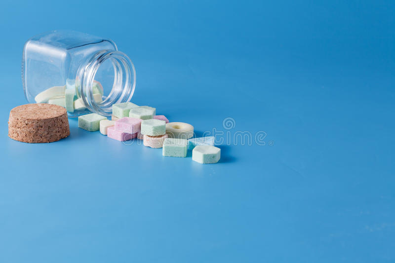 Sweet dragee spill from jar. Inviting card decoration concept. Sweet dragee spill from jar stock images