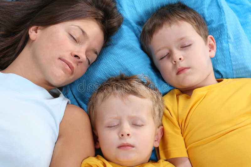 Sweet dreams. Mother and two sons sleeping royalty free stock photo