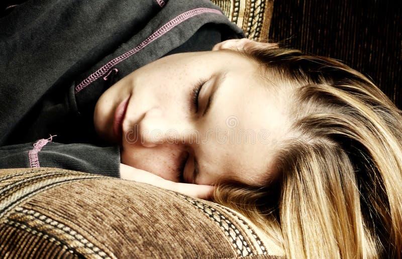 Sweet dreams. Young girl fallen asleep, dreaming