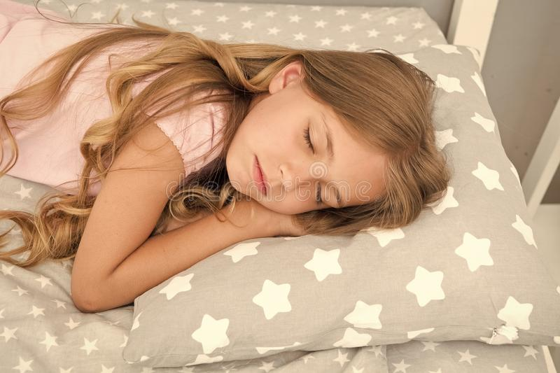 Sweet dreams. Girl child long hair fall asleep close up. Quality of sleep depends on many factors. Choose proper pillow. To sleep well. Girl on little pillow stock photo