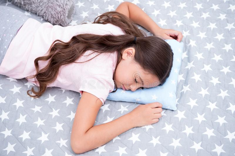 Sweet dreams. Girl child long hair fall asleep on pillow close up. Quality of sleep depends on many factors. Choose royalty free stock photography
