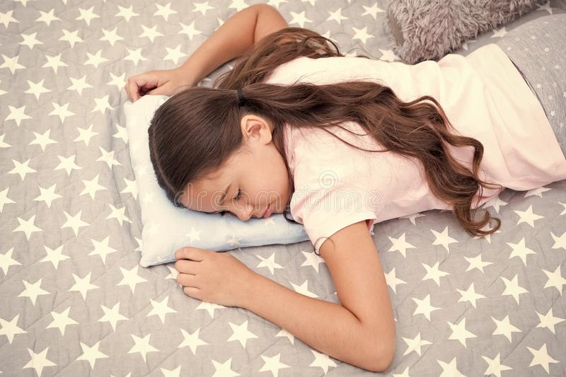 Sweet dreams. Girl child long hair fall asleep on pillow close up. Quality of sleep depends on many factors. Choose. Proper pillow to sleep well. Girl sleeps on stock images