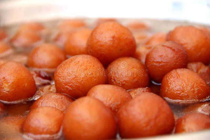 Sweet Dreams with Gulab Jamun. It is a milk-solid-based South Asian sweet, particularly popular in the Indian subcontinent, notably India, Nepal royalty free stock image
