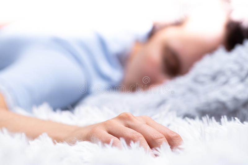 Sweet dreams are made of furry pillows. Person sleeping immersed in furry pillows and blanket stock photography