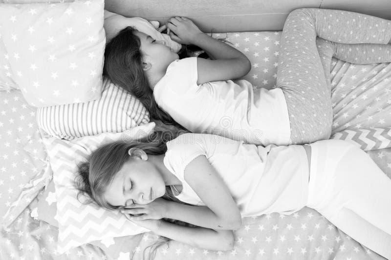 Sweet dreams. sweet dreams of two little girls sleeping in bed. little girls sisters sleep at night. Sweet dreams. sweet dreams of two little girls sleeping in stock photography