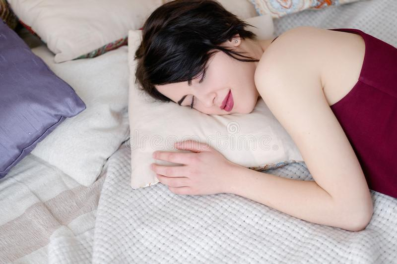 Sweet dreams woman sleep pillow bedroom rest. Sweet dreams. woman sleeps on a pillow in her bedroom. daydream rest concept royalty free stock photos