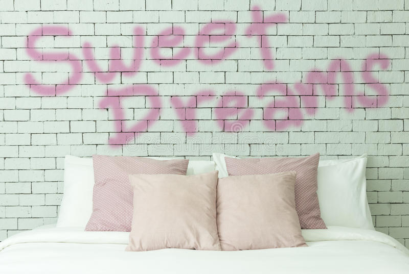 Sweet dreams word on white bricks wall background. Lettering word Sweet dreams on white bricks wall background royalty free stock photo