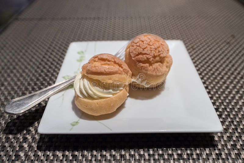 Sweet Eclair, Cream Puff, or Choux royalty free stock photography