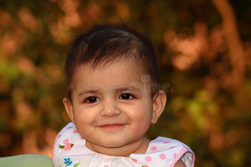 Sweet face of a small baby royalty free stock photography