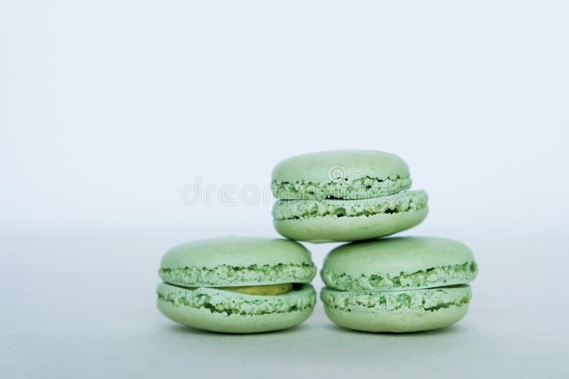 Sweet french macaron cookies. Pastry, patisserie and confectionery. Neo mint color of the year 2020 stock photo