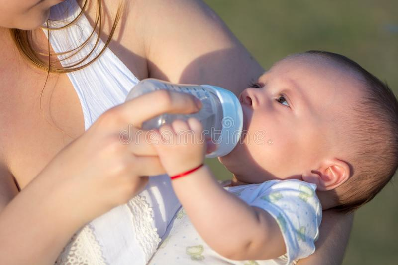 Sweet funny baby drinking water royalty free stock photography