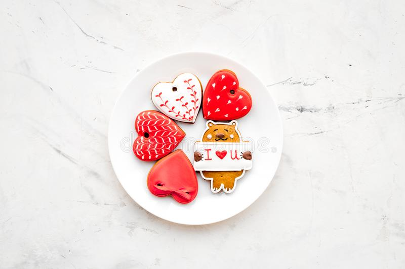 Sweet gift for St Valentine`s Day. Heart shaped gingerbread on light grey background top view copy space royalty free stock photos