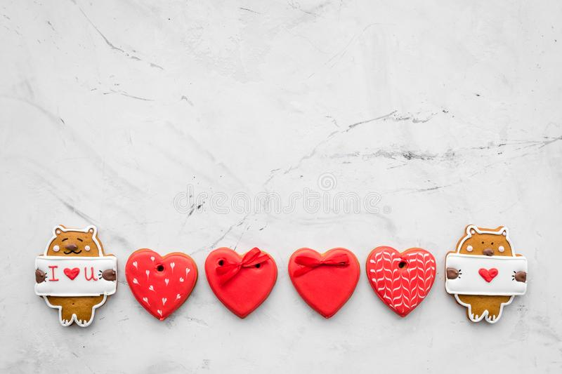Sweet gift for St Valentine`s Day. Heart shaped gingerbread on light grey background top view copy space royalty free stock images