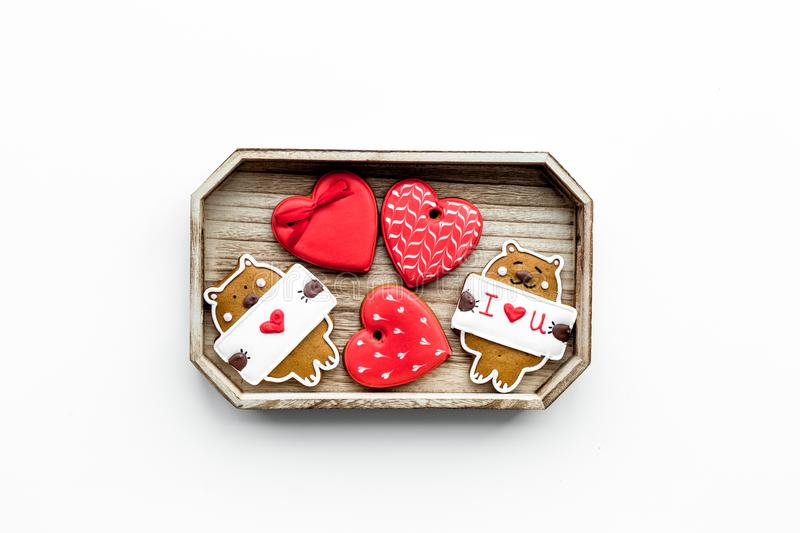 Sweet gift on Valentine`s Day. Heart shaped cookies and bear with lettering I love you on white background top view copy royalty free stock photos