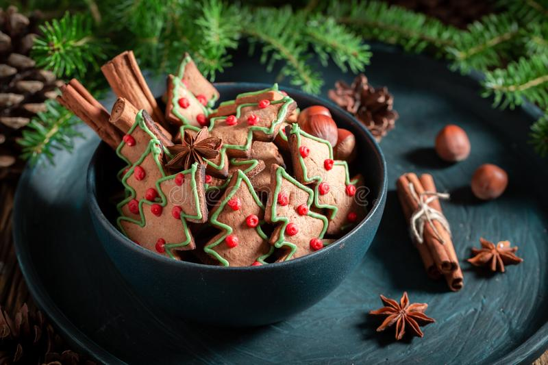 Sweet gingerbread cookies for Christmas on rustic tray stock photos