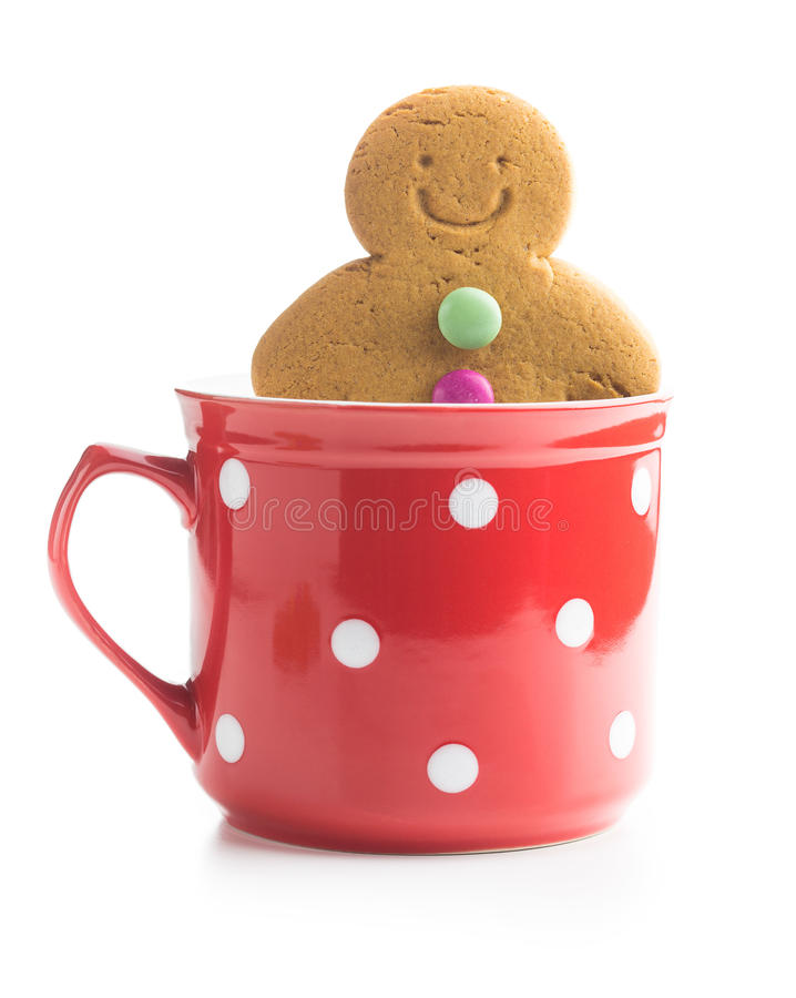 Sweet gingerbread man in cup. Sweet gingerbread man in cup isolated on white background. Xmas gingerbread royalty free stock image