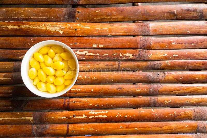 A Sweet Ginkgo Nut Soup ON bamboo table image top view stock photography