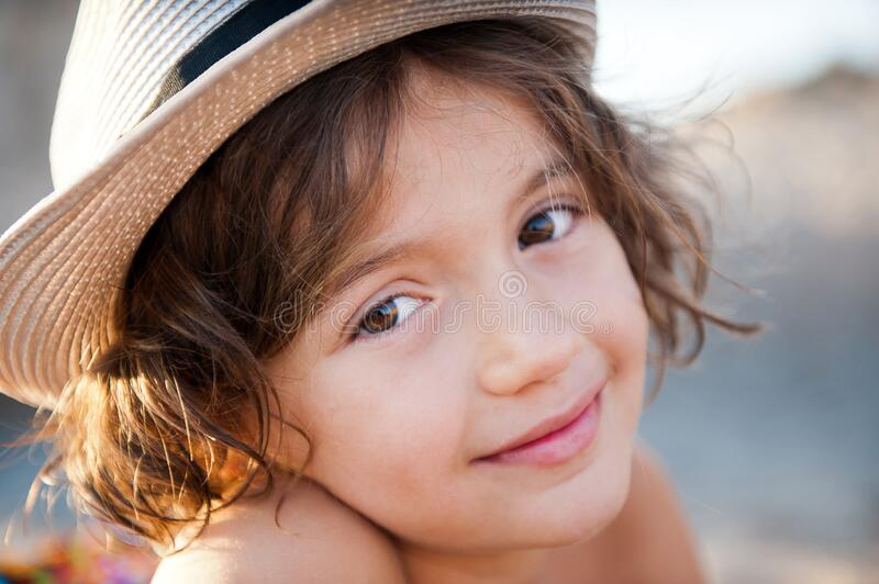 Sweet girl in a hat against nature. stock photo