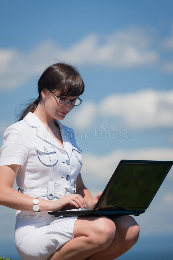 Download Sweet Girl With A Laptop Sits On A Rock Stock Image - Image: 15462291