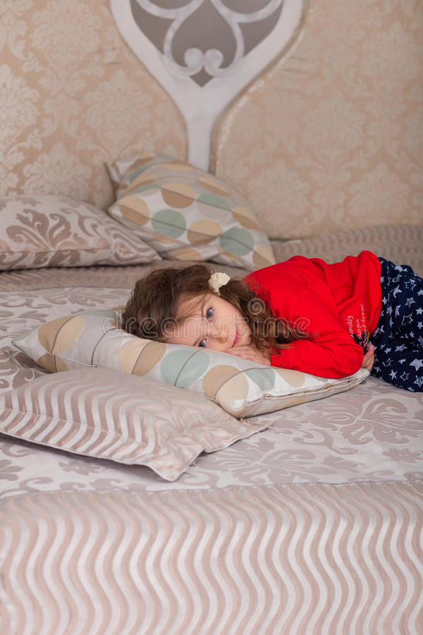 Download Sweet Girl In Pajamas Getting Ready For Bed Stock Photo - Image: 83720074