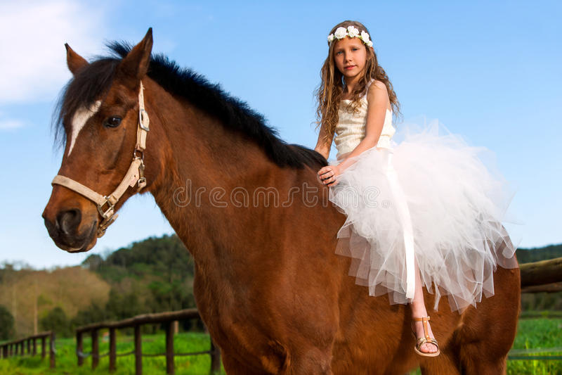 Sweet girl riding horse. royalty free stock images