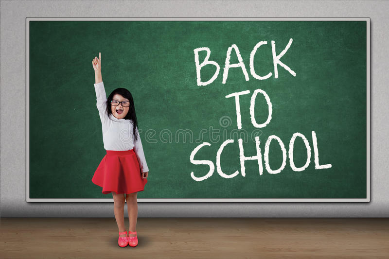 Sweet girl rise hand in class stock image