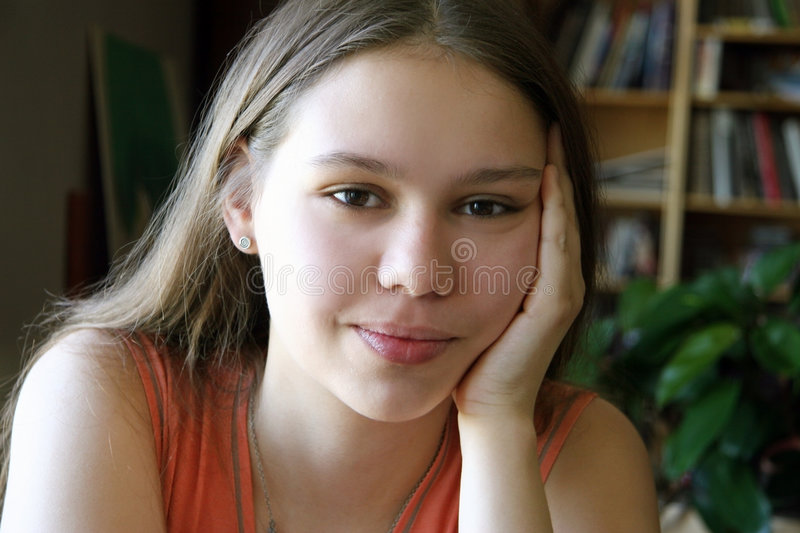 Sweet girl by the window royalty free stock photo