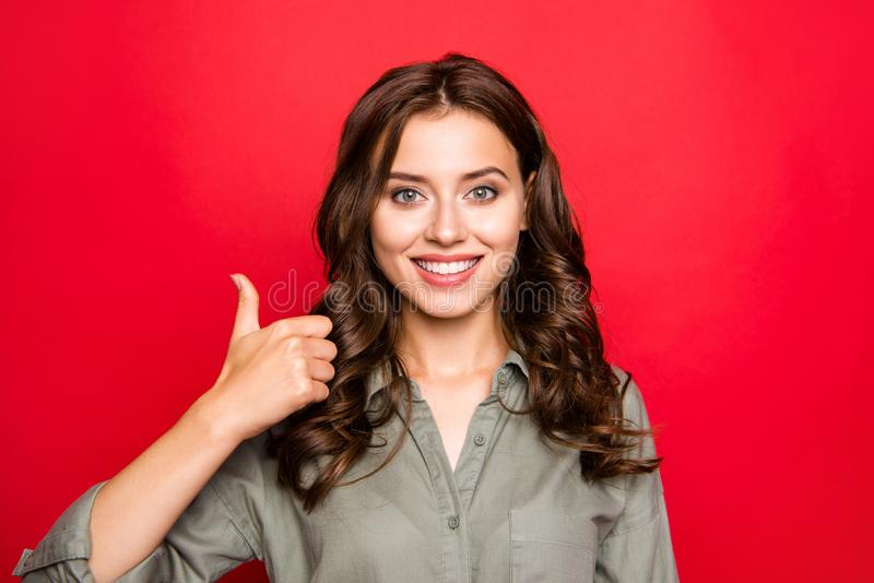 Sweet, gorgeous, good-looking, stylish, trendy young lady in blo. Use with white toothy smile give thumb up look at camera isolated on bright red background stock photos