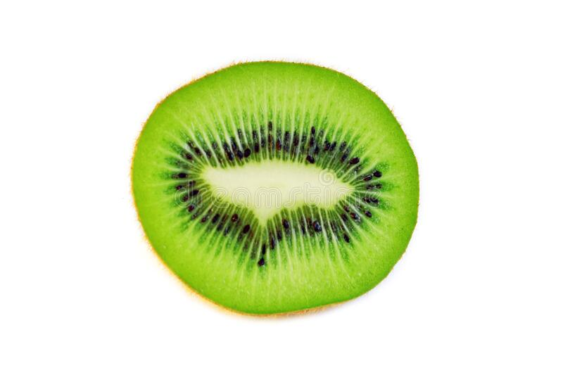 Sweet green juicy kiwi fruit slice macro isolated on white for design packaging. Sweet green juicy kiwi fruit slice macro shoot isolated on white for design stock image