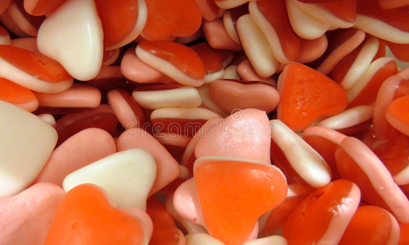 Sweet hearts. Sweet hart shaped red candy royalty free stock photos
