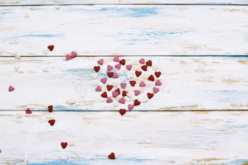 Sweet hearts Valentine card on wood background. Sweet hearts Valentine card on white and blue backdround in center stock photography