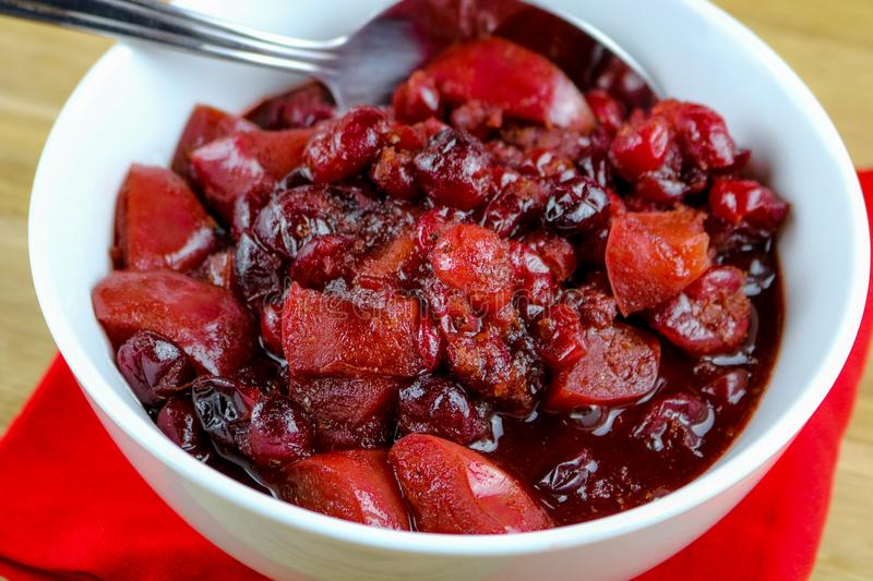 Sweet Holiday Chutney. A bowl of homemade sweet holiday cranberry and apple chutney royalty free stock image