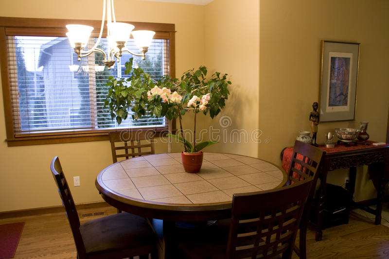 Sweet home dining room. A dining room with nice furniture royalty free stock photo