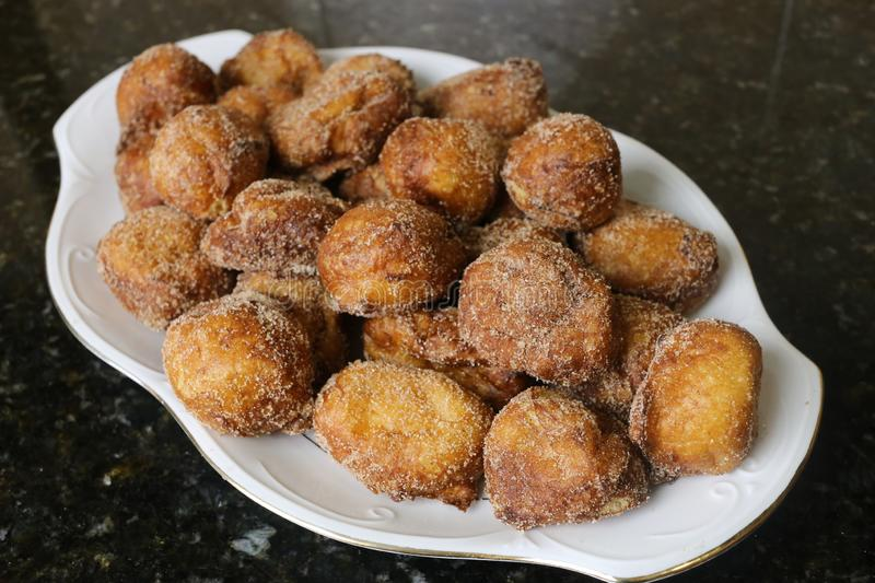 Sweet home fried for christmas. The fritters are a very popular homemade sweet, they are eaten as breakfast, snack or dessert and at Christmas stock photography