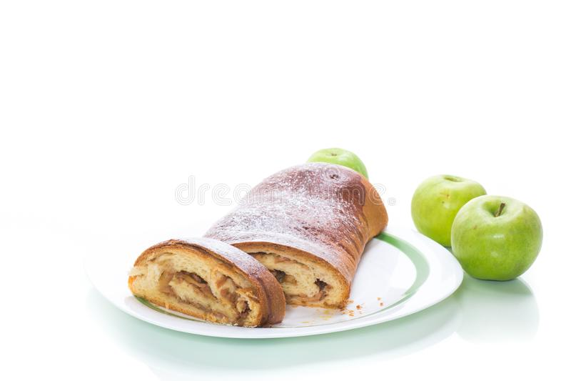 Sweet homemade apple strudel isolated on white. Background royalty free stock photography