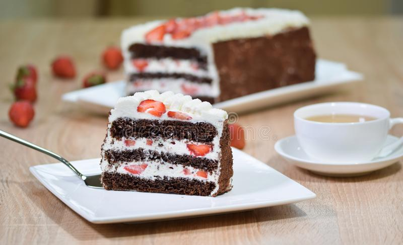 Sweet homemade cake with strawberry and whipped cream close up royalty free stock photo