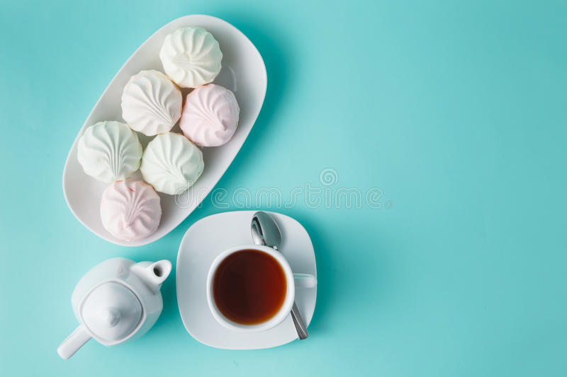 Sweet homemade dessert - berry marshmallow (zephyr) on a plain a. Quamarine background, selective focus stock images