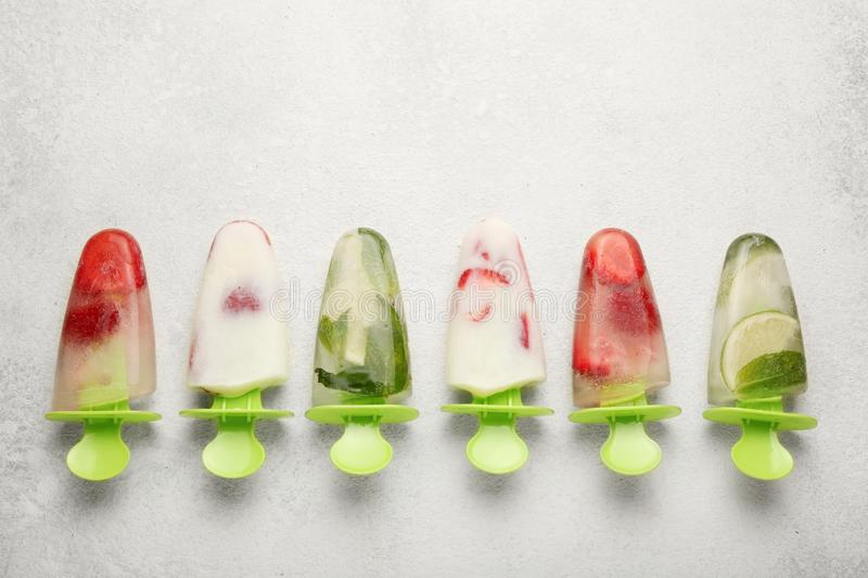 Sweet homemade dessert, popsicles sorbet for summer coolness. Frozen juice and ice cream royalty free stock photography