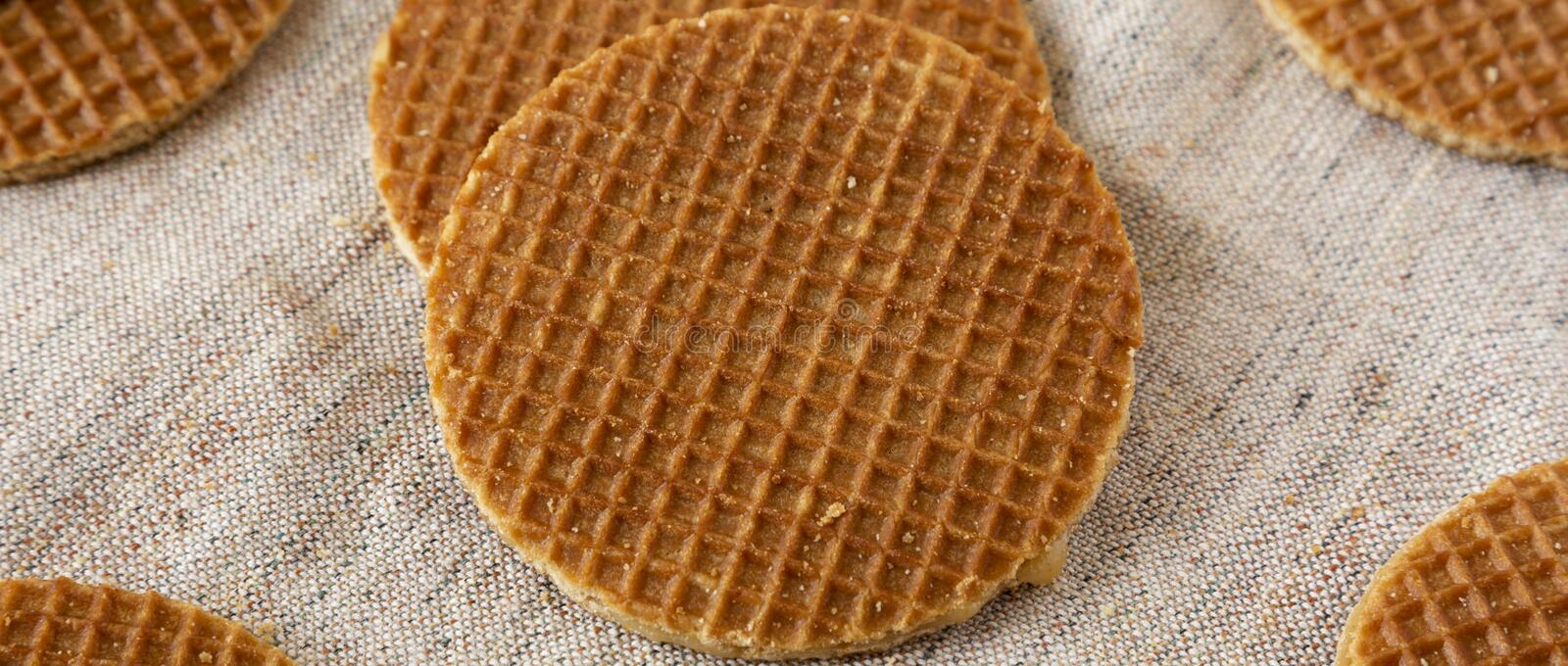 Sweet homemade dutch stroopwafels with honey-caramel filling on cloth, low angle view. Closeup.  stock images